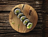 Futomaki sushi with mange tout, avocado and cucumber