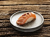 Nigiri sushi with fried salmon and teriyaki sauce