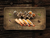 Sushi with prawns, sesame seeds and teriyaki sauce