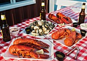 A table laid outside with lobster, mussels and beer (USA)