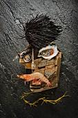 Rockstar-Gesicht aus Meeresfrüchten und Seeigel