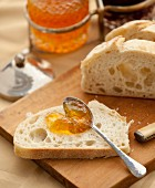 Marmalade spread on a slice of homemade bread