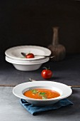 Cream of tomato soup with pepper and sorrel