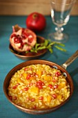 Pumpkin risotto with pomegranate seeds