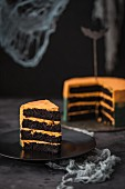 Sliced Halloween chocolate cake filled with cream