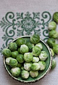 Brussels sprouts on an embroidered tablecloth