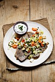 Prime boiled beef with vegetables and chive sour cream