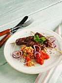 Cevapcici with tomato rice and onions