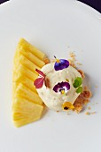 Pineapple with pepper cream, edible flowers and crumbles