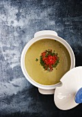 Potato soup with leek and salmon caviar