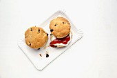 Spelt scones with dried cherries and allspice on a paper plate
