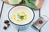 Kohlrabi soup with cress, olive oil, nutmeg and star anise