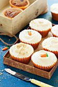 Spelt and carrot cupcakes decorated with sugar carrots