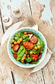 Spinach salad with spicy roasted chickpeas and chorizo
