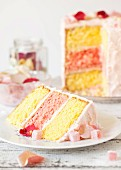 A slice of Turkish Delight layer cake with rose petals