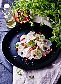 White beetroot carpaccio with onions and pomegranate seeds