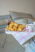 Fresh croissants with jam and coffee in a bed
