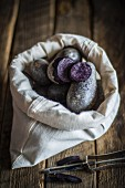 Purple potatoes in a fabric bag