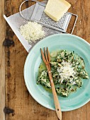 Strangolapreti (Italian ricotta and spinach dumplings) with grated cheese