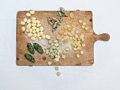 Various gnocchi on a chopping board
