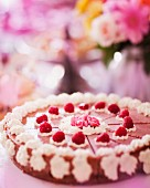 Summer raspberry cake decorated with cream