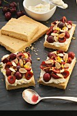 Shortbread with fresh cherries and flaked almonds