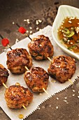 Chicken meatballs on sticks with sesame seeds (Japan)