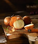 Onions on a wooden chopping board