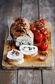Turkey breast roulade stuffed with courgette, feta cheese and dried tomatoes