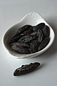 Dried tonka beans in a dish