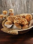 Homemade spelt rye rolls in a wooden bowl