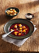Primeval carrots soup with mango and croutons (vegetarian)