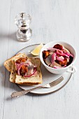 Herring pickled in vinegar with plums and red onions