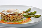 Quinoa timbale with fried egg and green asparagus