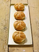 Four fresh bread rolls