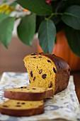 Pumpkin bread with raisins, dried cherries and pumpkin seeds, sliced