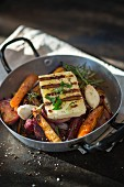 Grilled halloumi on oven-roasted vegetables
