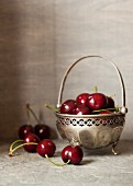 Fresh cherries in a silver bowl