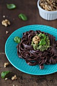 Chocolate pasta with homemade basil and walnut pesto