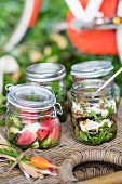 Assorted salads in preserving jars for a picnic