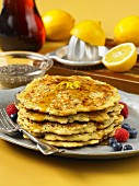 Pancakes with chia seeds, syrup and berries