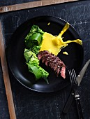 Beef with steamed savoy cabbage and sauce Bearnaise