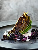 Pan-fried pointed cabbage with berries and olives