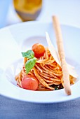 Spaghetti with cherry tomatoes, basil and grissini