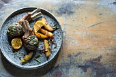 Lamb chops with herbs, lemons and potato wedges