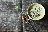 Celeriac soup with walnuts and chives