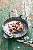 A slice of mascarpone and cherry cake