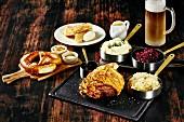 Oktober Fest food: pretzel, pork knuckle with side dishes and beer