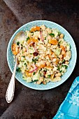 Couscous with cucumber, dried apricots and chickpeas
