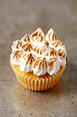 A lemon cupcake with a meringue topping